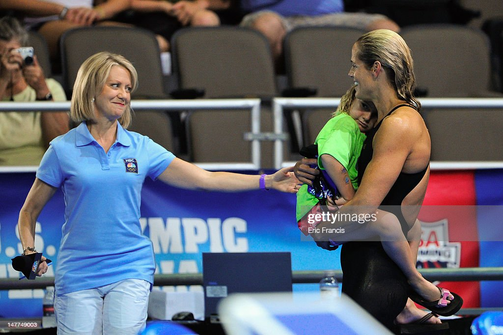<a gi-track='captionPersonalityLinkClicked' href=/galleries/search?phrase=Dara+Torres&family=editorial&specificpeople=2419430 ng-click='$event.stopPropagation()'>Dara Torres</a> holds her daughter Tessa and prepares to be interviewed after failing to qualify in the 50m Freestyle during day eight of the 2012 U.S. Olympic Swimming Team Trials at the CenturyLink Center July 2, 2012 in Omaha, Nebraska.