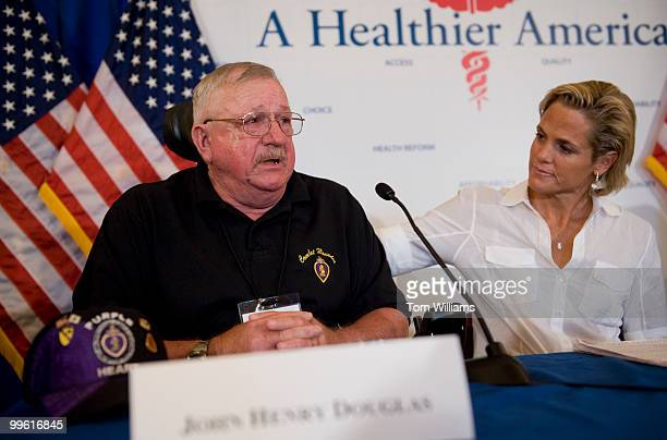 Dara Torres Olympic Gold Medal swimmer listens to John Henry Douglas Vietnam veteran and recipient of two purple hearts tell a story of his father's...
