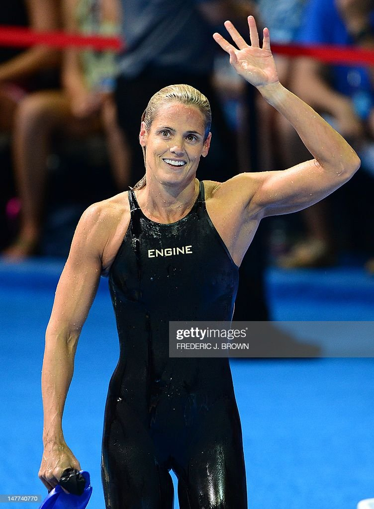 Dara Torres, 45, (C), waves towrads the direction of her daughter following the women's 50M Freestyle final on the last day of the 2012 US Olympic Team Trials on July 2, 2012 in Omaha, Nebraska which was won by Jessica Hardy as Torres came in fourth. AFP PHOTO/Frederic J. BROWN