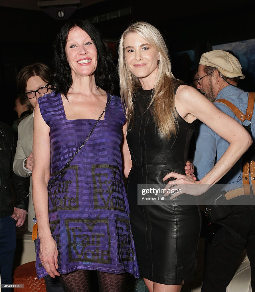 Darbury Stenderu (L) and Rock Paper Photo, Director of Fine Art Sales Jody Britt (wearing Rudsak) attend the FairVote Benefit hosted by Krist Novoselic and Rock Paper Photo at No.8 on April 11, 2014 in New York City.