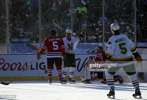 Darby Hendrickson of the Minnesota Wild/North Stars reacts after a goal by teammate Dennis Maruk during the 2016 Coors Light Stadium Series Alumni...