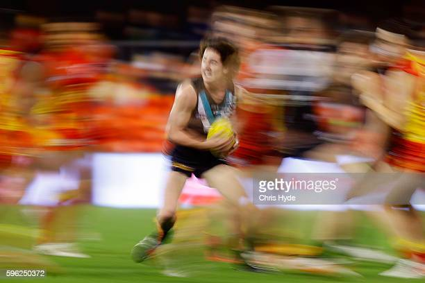 Darcey ByrneJones of the Power runs the ball during the round 23 AFL match between the Gold Coast Suns and the Port Adelaide Power at Metricon...