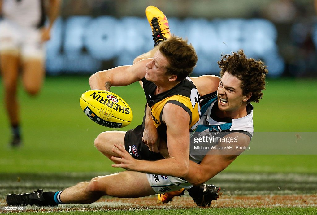 Darcy Byrne-Jones of the Power and Connor Menadue of the Tigers compete for the ball during the 2016 AFL Round 06 match between the Richmond Tigers and Port Adelaide Power at the Melbourne Cricket Ground on April 30, 2016 in Melbourne, Australia.