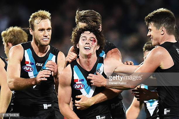 Darcy ByrneJones of the Power is congratulated by his team mates after scoring his first career goal during the round three AFL match between the...