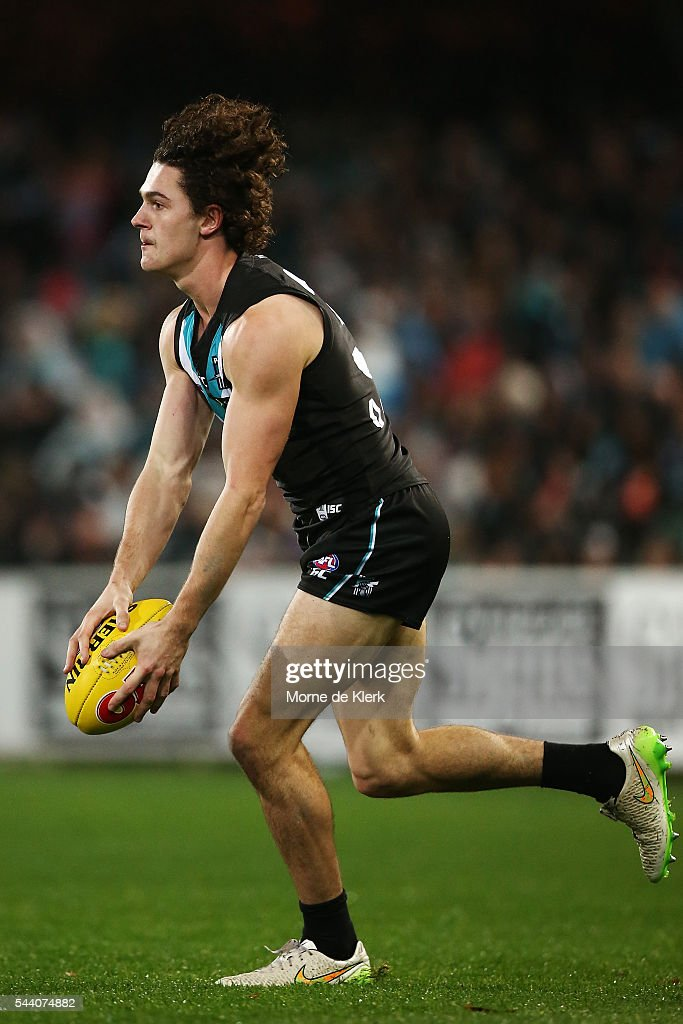 Darcy Byrne-Jones of the Power runs with the ball during the round 15 AFL match between the Port Adelaide Power and the Richmond Tigers at Adelaide Oval on July 1, 2016 in Adelaide, Australia.