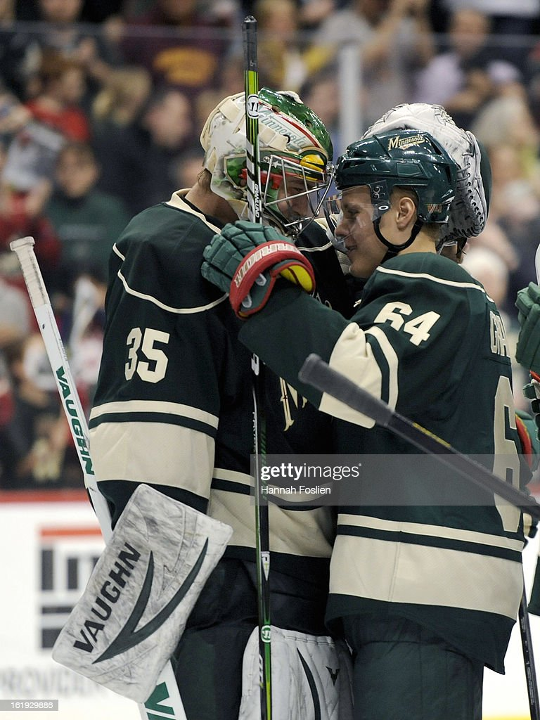 Darcy Kuemper #35 and Mikael Granlund #64 of the Minnesota Wild celebrate a win of the game against the Detroit Red Wings on February 17, 2013 at Xcel Energy Center in St Paul, Minnesota. The Wild defeated the Red Wings 3-2.