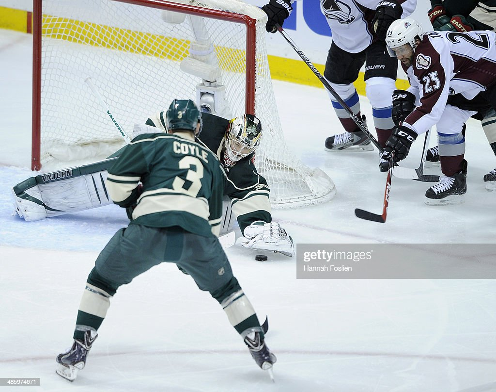 <a gi-track='captionPersonalityLinkClicked' href=/galleries/search?phrase=Darcy+Kuemper&family=editorial&specificpeople=6270733 ng-click='$event.stopPropagation()'>Darcy Kuemper</a> #35 of the Minnesota Wild covers up the puck as teammate <a gi-track='captionPersonalityLinkClicked' href=/galleries/search?phrase=Charlie+Coyle&family=editorial&specificpeople=7029381 ng-click='$event.stopPropagation()'>Charlie Coyle</a> #3 looks on along with <a gi-track='captionPersonalityLinkClicked' href=/galleries/search?phrase=Maxime+Talbot&family=editorial&specificpeople=2078922 ng-click='$event.stopPropagation()'>Maxime Talbot</a> #25 of the Colorado Avalanche during the second period in Game Three of the First Round of the 2014 NHL Stanley Cup Playoffs on April 21, 2014 at Xcel Energy Center in St Paul, Minnesota. The Wild defeated the Avalanche 1-0 in overtime.
