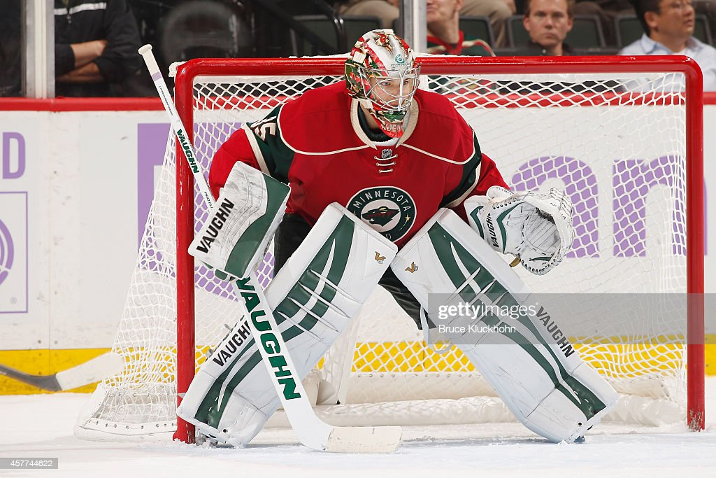 Darcy Kuemper of the Minnesota Wild defends his goal against the Arizona Coyotes during the game on October 23 2014 at the Xcel Energy Center in St...