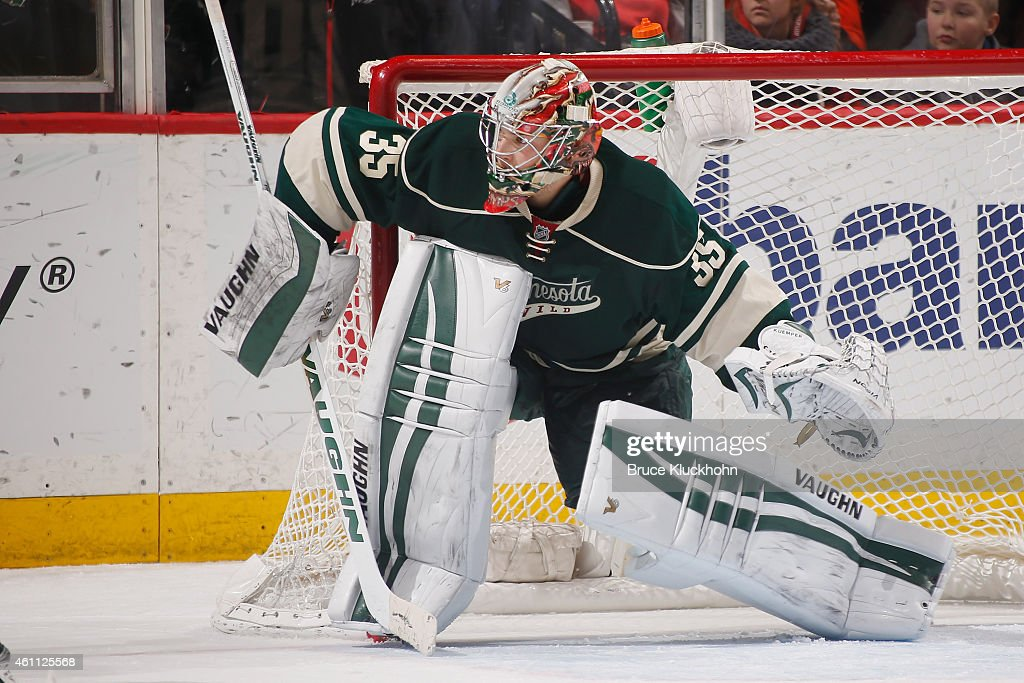 Darcy Kuemper of the Minnesota Wild defends his goal against the Toronto Maple Leafs during the game on January 2 2015 at the Xcel Energy Center in...