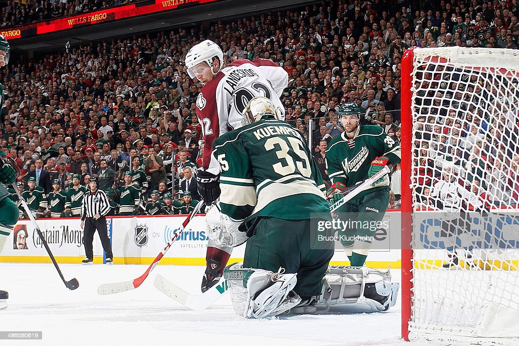 <a gi-track='captionPersonalityLinkClicked' href=/galleries/search?phrase=Darcy+Kuemper&family=editorial&specificpeople=6270733 ng-click='$event.stopPropagation()'>Darcy Kuemper</a> #35 of the Minnesota Wild defends his net against <a gi-track='captionPersonalityLinkClicked' href=/galleries/search?phrase=Gabriel+Landeskog&family=editorial&specificpeople=6590816 ng-click='$event.stopPropagation()'>Gabriel Landeskog</a> #92 and the Colorado Avalanche during Game Four of the First Round of the 2014 Stanley Cup Playoffs on April 24, 2014 at the Xcel Energy Center in St. Paul, Minnesota.