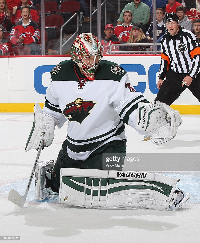 Darcy Kuemper of the Minnesota Wild defends his net against the New Jersey Devils during the game at the Prudential Center on November 11 2014 in...