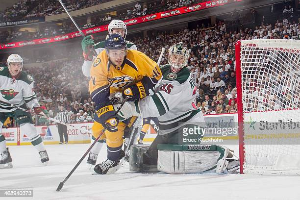 Darcy Kuemper of the Minnesota Wild defends Taylor Beck of the Nashville Predators during the game on February 6 2014 at the Xcel Energy Center in St...