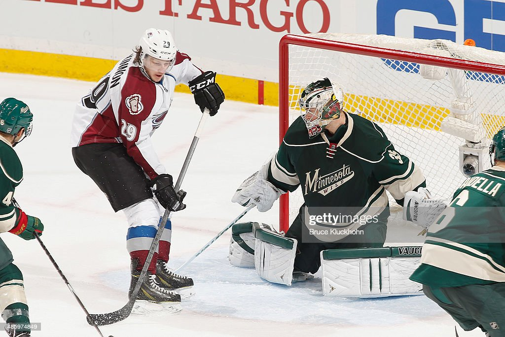 <a gi-track='captionPersonalityLinkClicked' href=/galleries/search?phrase=Darcy+Kuemper&family=editorial&specificpeople=6270733 ng-click='$event.stopPropagation()'>Darcy Kuemper</a> #35 of the Minnesota Wild defends the net against <a gi-track='captionPersonalityLinkClicked' href=/galleries/search?phrase=Nathan+MacKinnon&family=editorial&specificpeople=8610127 ng-click='$event.stopPropagation()'>Nathan MacKinnon</a> #29 of the Colorado Avalanche during Game Three of the First Round of the 2014 Stanley Cup Playoffs on April 21, 2014 at the Xcel Energy Center in St. Paul, Minnesota.