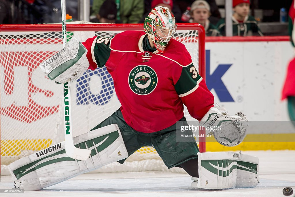 Darcy Kuemper of the Minnesota Wild gives up a rebound that leads to a San Jose Sharks goal during the game on January 6 2015 at the Xcel Energy...
