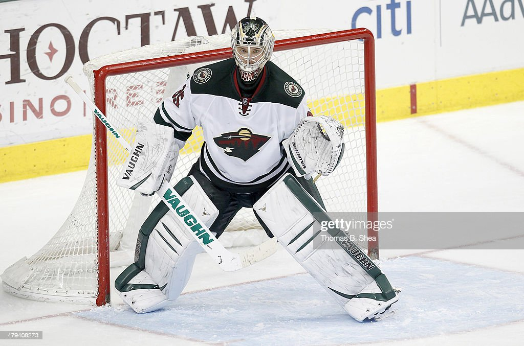 Darcy Kuemper of the Minnesota Wild in goal against the Dallas Stars on March 8 2014 at American Airlines Center in Dallas Texas Dallas won 43