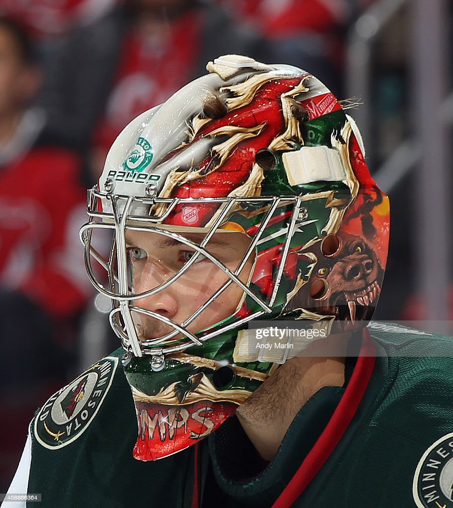 Darcy Kuemper of the Minnesota Wild looks on against the New Jersey Devils during the game at the Prudential Center on November 11 2014 in Newark New...