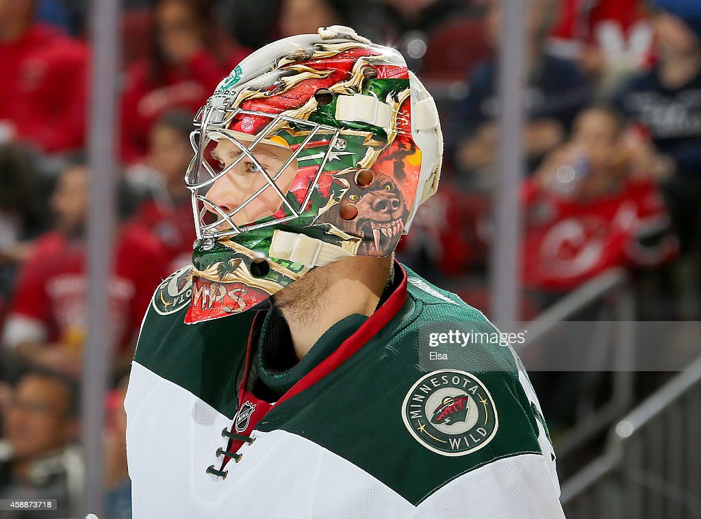 Darcy Kuemper of the Minnesota Wild looks on in the second period against the New Jersey Devils on November 11 2014 at the Prudential Center in...