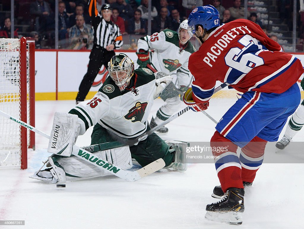 Darcy Kuemper #35 of the Minnesota Wild makes a blocker save on a shot by Max Pacioretty #67 of the Montreal Canadiens during the NHL game on November 19, 2013 at the Bell Centre in Montreal, Quebec, Canada.