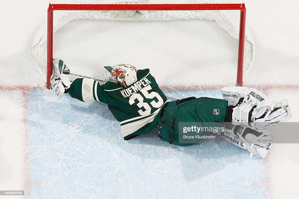 Darcy Kuemper of the Minnesota Wild makes a diving save against the Toronto Maple Leafs during the game on January 2 2015 at the Xcel Energy Center...