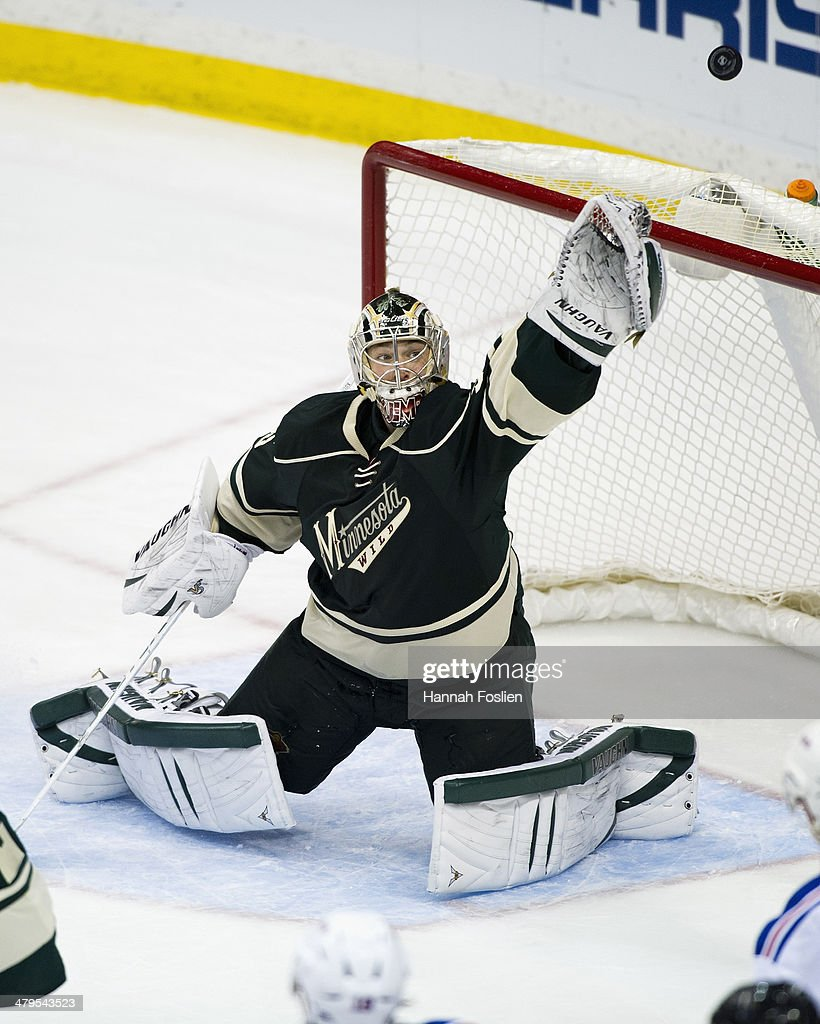 Darcy Kuemper of the Minnesota Wild makes a glove save during the game against the New York Rangers on March 13 2014 at Xcel Energy Center in St Paul...