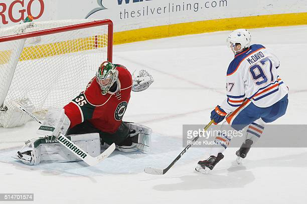 Darcy Kuemper of the Minnesota Wild makes a save against Connor McDavid of the Edmonton Oilers during the game on March 10 2016 at the Xcel Energy...