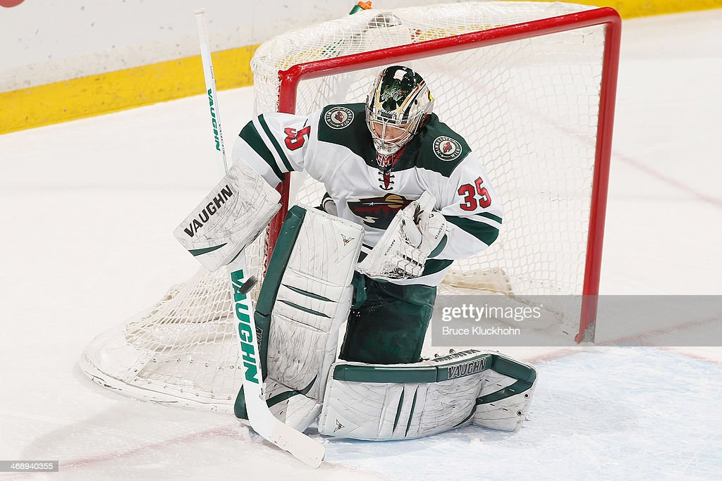 Darcy Kuemper of the Minnesota Wild makes a save against the Nashville Predators during the game on February 6 2014 at the Xcel Energy Center in St...