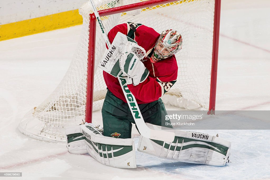 Darcy Kuemper of the Minnesota Wild makes a save against the Los Angeles Kings during the game on November 26 2014 at the Xcel Energy Center in St...