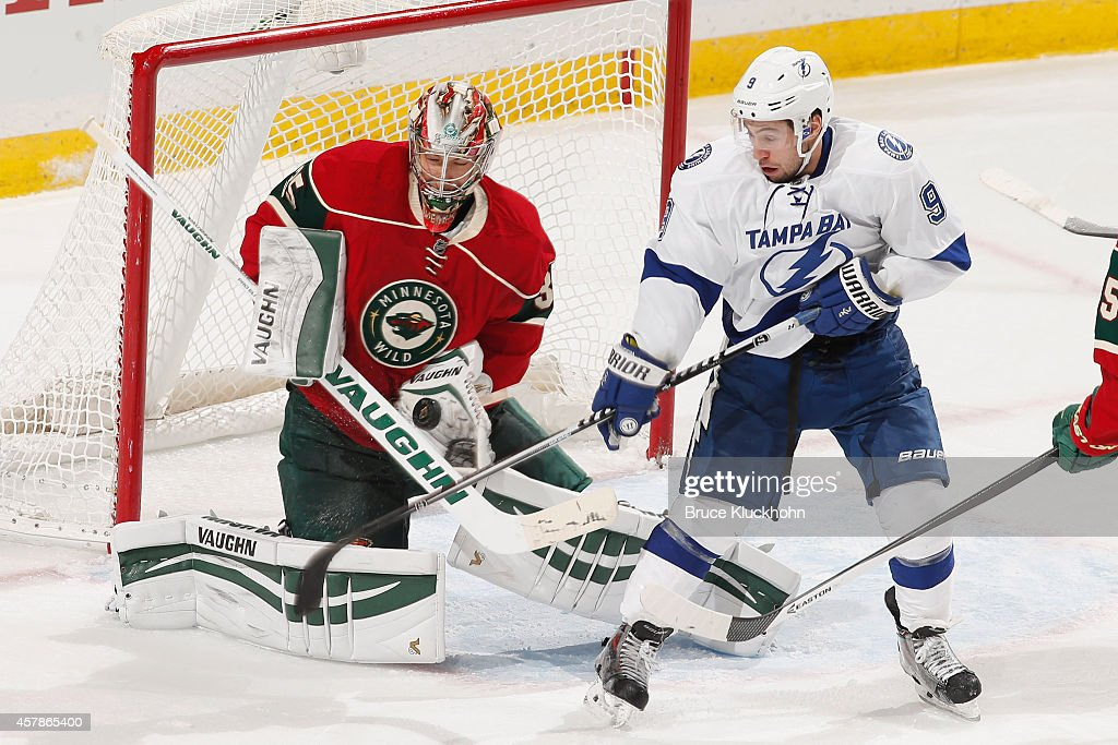 Darcy Kuemper of the Minnesota Wild makes a save against Tyler Johnson of the Tampa Bay Lightning during the game on October 25 2014 at the Xcel...