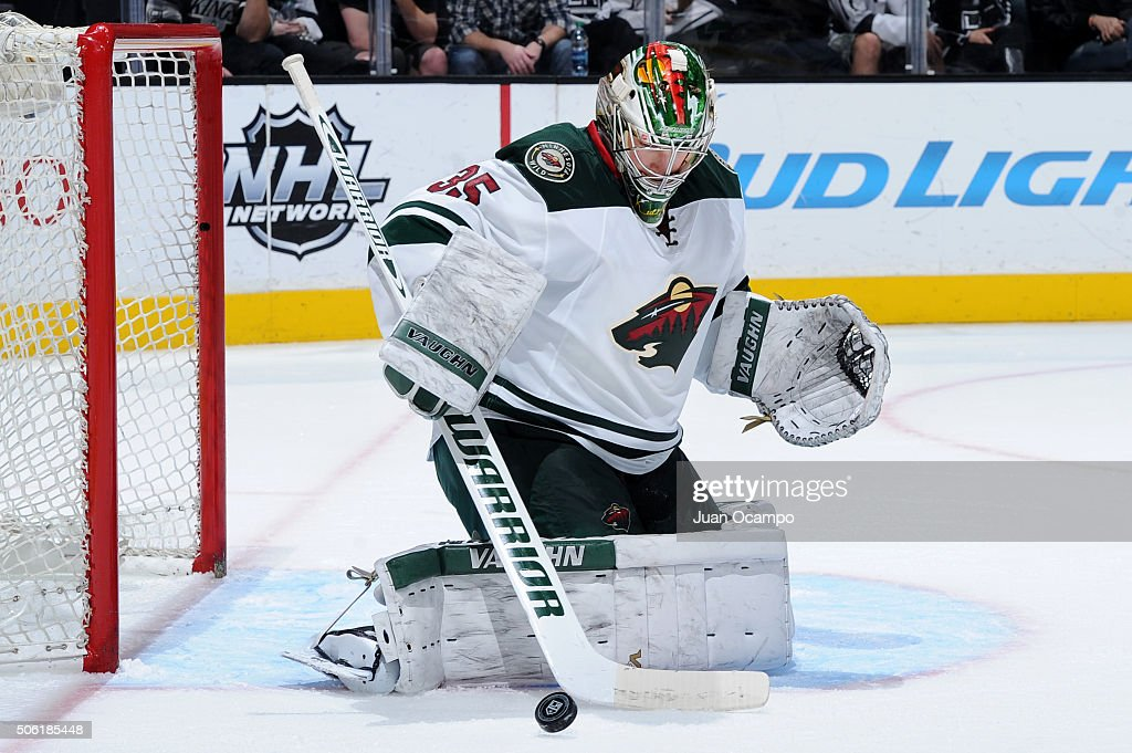 Darcy Kuemper of the Minnesota Wild makes a save during the game against the Los Angeles Kings on January 21 2016 at Staples Center in Los Angeles...
