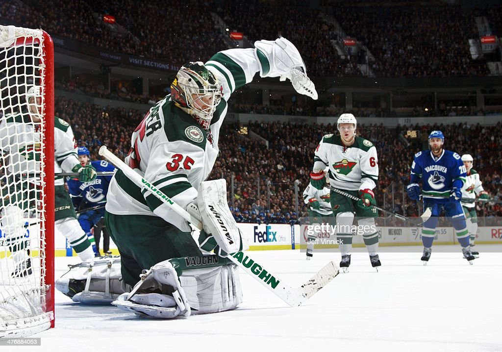 Darcy Kuemper of the Minnesota Wild makes a save during their NHL game against the Vancouver Canucks at Rogers Arena February 28 2014 in Vancouver...