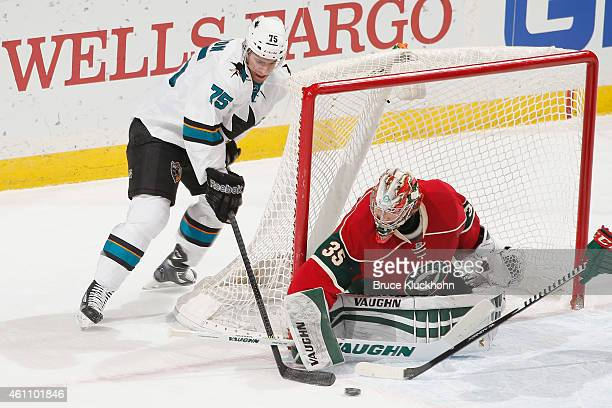 Darcy Kuemper of the Minnesota Wild makes save against Freddie Hamilton of the San Jose Sharks during the game on January 6 2015 at the Xcel Energy...