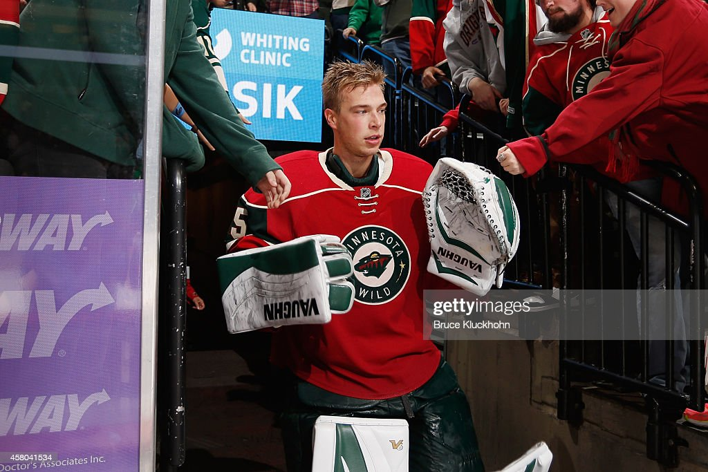 Darcy Kuemper of the Minnesota Wild returns to the ice after being named one of the stars of the game against the Arizona Coyotes on October 23 2014...