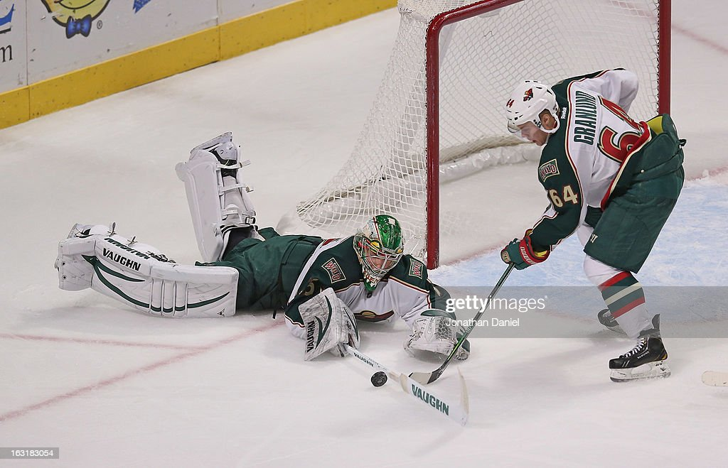 Darcy Kuemper #35 of the Minnesota Wild stops a shot against the Chicago Blackhawks as <a gi-track='captionPersonalityLinkClicked' href=/galleries/search?phrase=Mikael+Granlund&family=editorial&specificpeople=5649678 ng-click='$event.stopPropagation()'>Mikael Granlund</a> readies to clear the puck at the United Center on March 5, 2013 in Chicago, Illinois. The Blackhawks defeated the Wild 5-3.