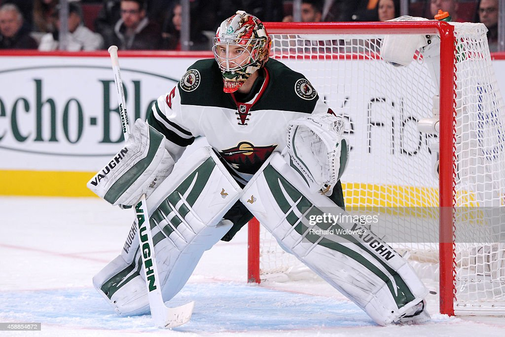Darcy Kuemper of the Minnesota Wild watches play during the NHL game against the Montreal Canadiens at the Bell Centre on November 8 2014 in Montreal...