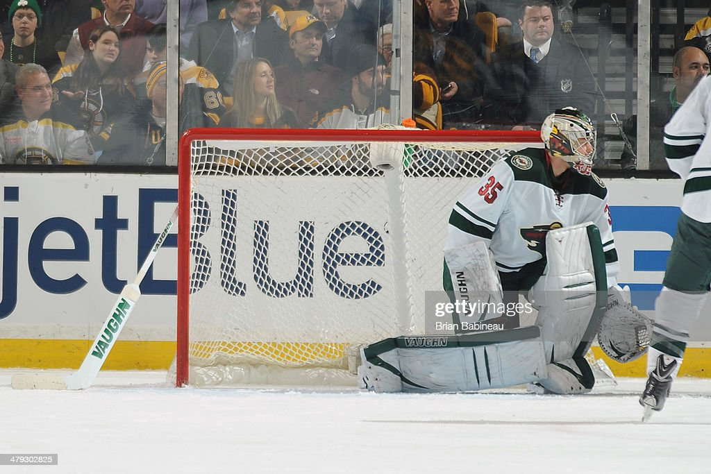Darcy Kuemper of the Minnesota Wild watches the play without his stick against the Boston Bruins at the TD Garden on March 17 2014 in Boston...