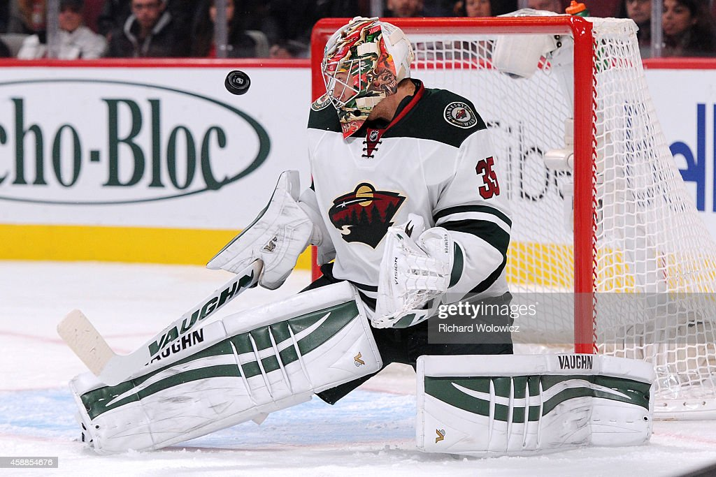 Darcy Kuemper of the Minnesota Wild watches the rebounding puck during the NHL game against the Montreal Canadiens at the Bell Centre on November 8...
