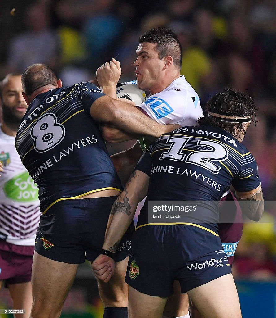 Darcy Lussick of the Sea Eagles is tackled by Matthew Scott and Ethan Lowe of the Cowboys during the round 16 NRL match between the North Queensland Cowboys and the Manly Sea Eagles at 1300SMILES Stadium on June 27, 2016 in Townsville, Australia.