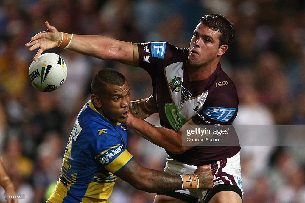 Darcy Lussick of the Sea Eagles offloads the ball in a tackle during the round seven NRL match between the Manly Sea Eagles and Parramatta Eels at Brookvale Oval on April 14, 2016 in Sydney, Australia.