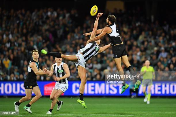 Darcy Moore of the Magpies and Patrick Ryder of the Power compete for the ruck during the round 21 AFL match between Port Adelaide Power and the...