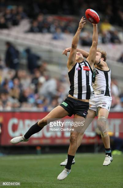 Darcy Moore of the Magpies attempts to mark during the round 14 AFL match between the Collingwood Magpies and the Port Adelaide Power at Melbourne...