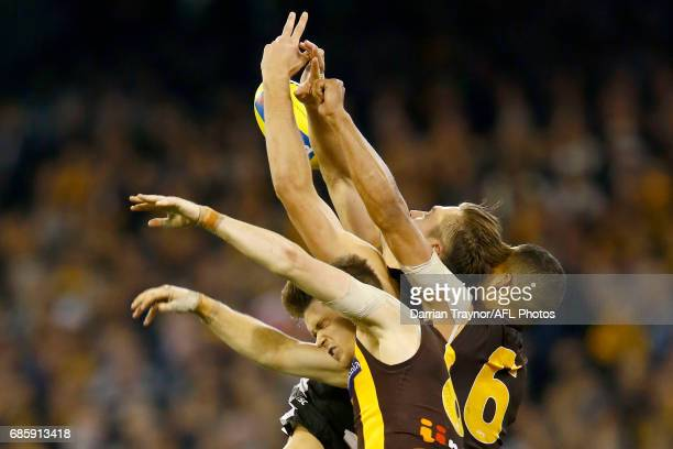 Darcy Moore of the Magpies attempts to mark the ball during the round nine AFL match between the Collingwood Magpies and the Hawthorn Hawks at...