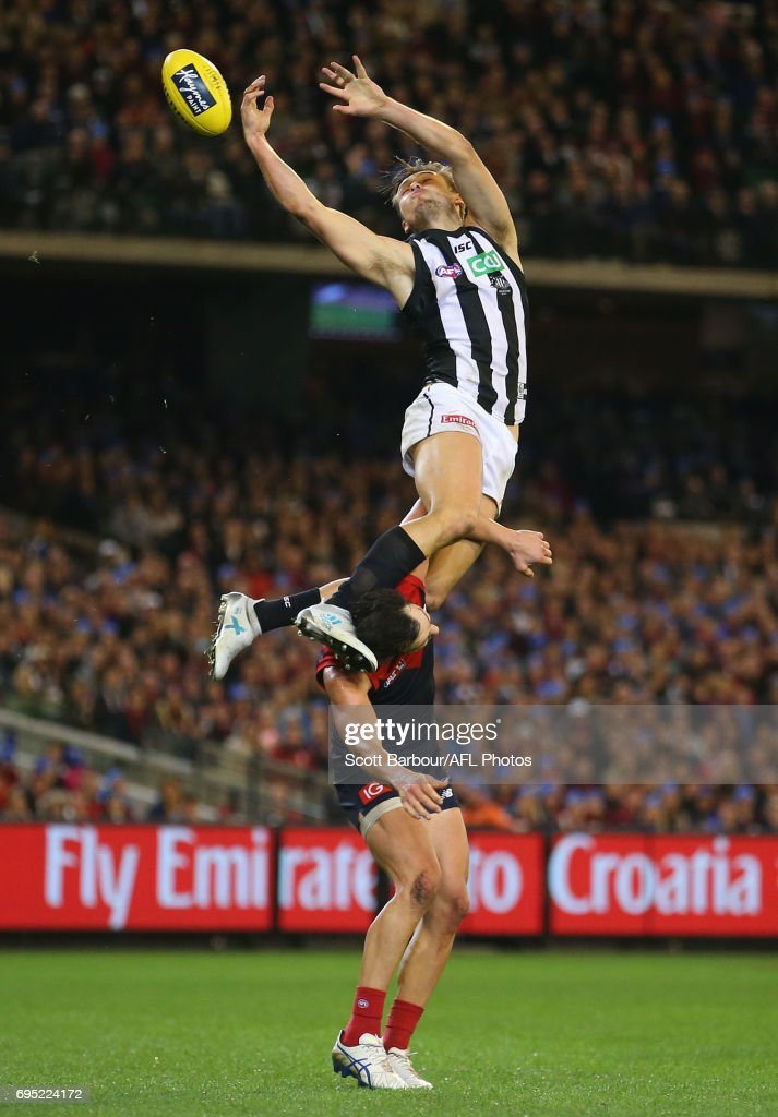 Darcy Moore of the Magpies attempts to mark the ball during the round 12 AFL match between the Melbourne Demons and the Collingwood Magpies at Melbourne Cricket Ground on June 12, 2017 in Melbourne, Australia.