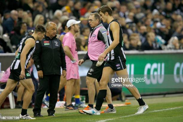 Darcy Moore of the Magpies comes from the ground with an injury during the round 18 AFL match between the Collingwood Magpies and the West Coast...