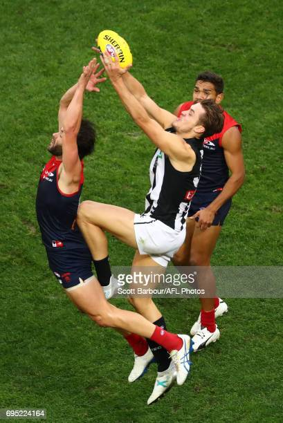 Darcy Moore of the Magpies competes for the ball during the round 12 AFL match between the Melbourne Demons and the Collingwood Magpies at Melbourne...