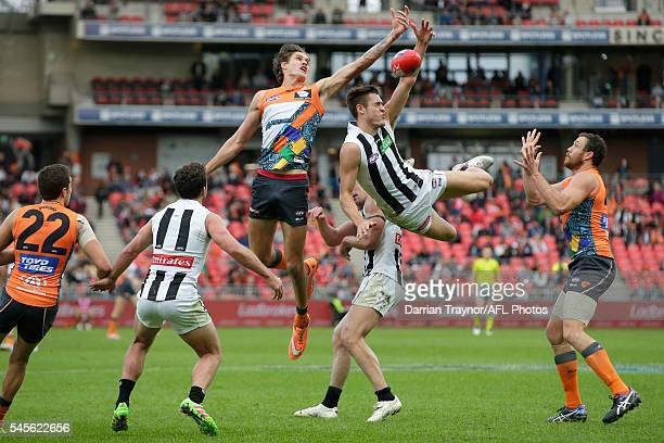 Darcy Moore of the Magpies jumps for the ball in an attempt to mark during the round 16 AFL match between the Greater Western Sydney Giants and the...