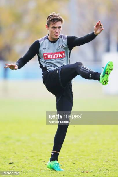 Darcy Moore of the Magpies kicks the ball during a Collingwood Magpies AFL training session at Gosch's Paddock on June 19 2017 in Melbourne Australia