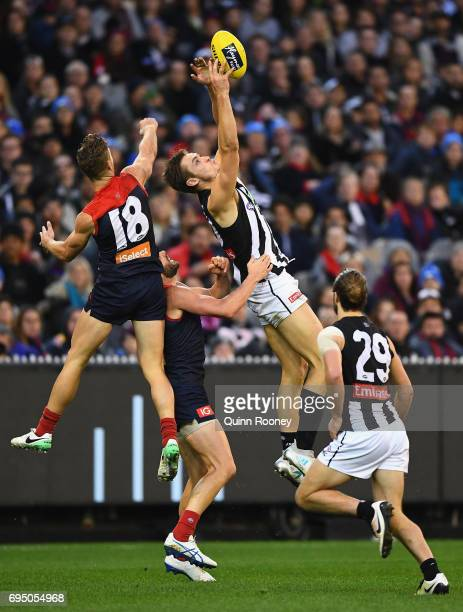 Darcy Moore of the Magpies marks during the round 12 AFL match between the Melbourne Demons and the Collingwood Magpies at Melbourne Cricket Ground...
