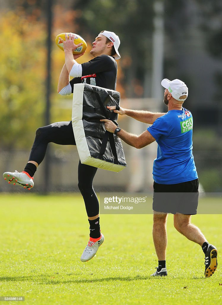 Darcy Moore of the Magpies marks the ball during a Collingwood Magpies AFL training session on May 27, 2016 in Melbourne, Australia.