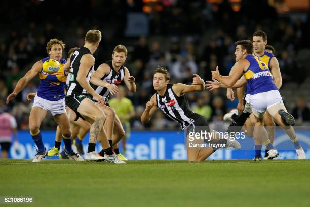 Darcy Moore of the Magpies Tom Stewart of the Cats the ball clear during the round 18 AFL match between the Collingwood Magpies and the West Coast...