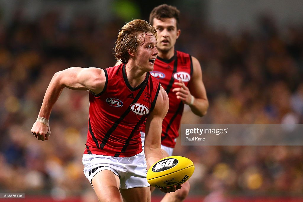 Darcy Parish of the Bomberslooks to handball during the round 15 AFL match between the West Coast Eagles and the Essendon Bombers at Domain Stadium on June 30, 2016 in Perth, Australia.